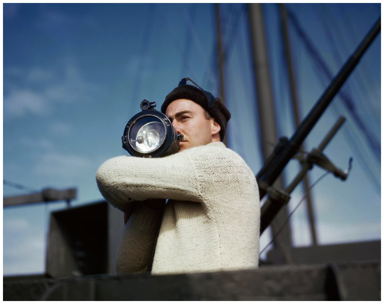 a-crewman-signals-another-ship-of-an-allied-convoy-across-the-atlantic-from-the-us-to-england-1942-photo-robert-capa