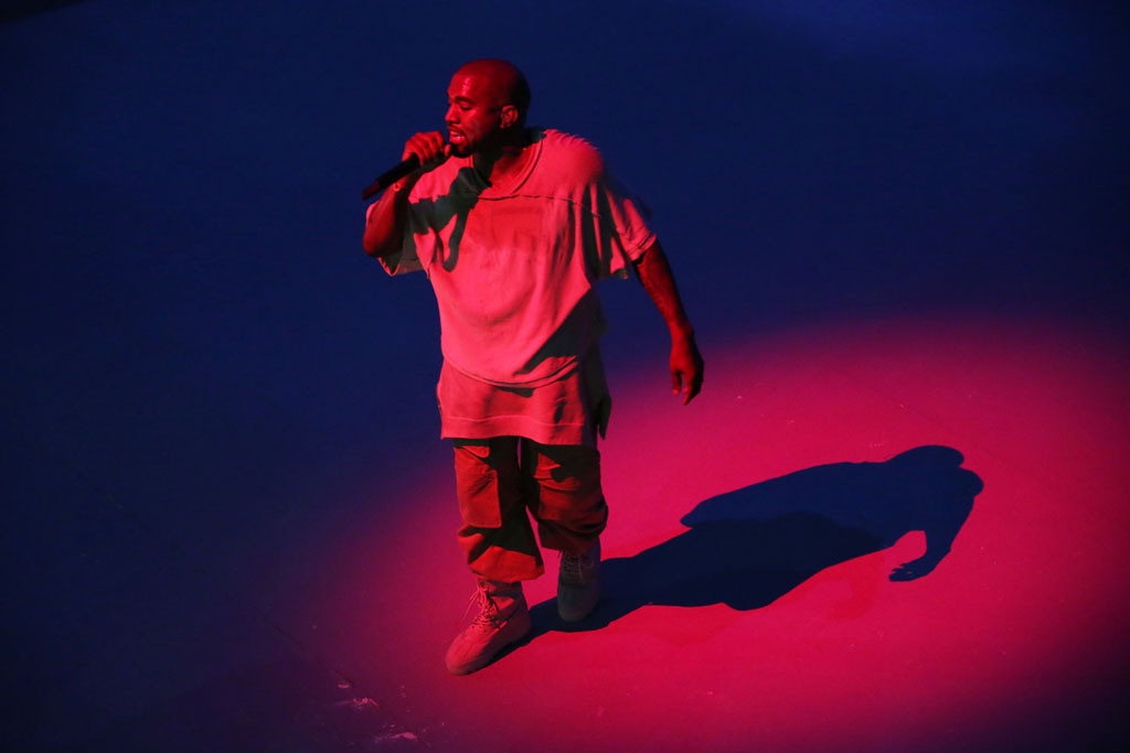 Kanye West performing at the Louis Vuitton Foundation.