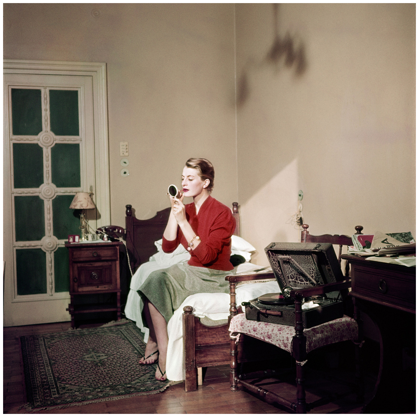 robert-capa-capucine-french-model-and-actress-in-her-hotel-room-rome-august-1951-c2a9-robert-capainternational-center-of-photographymagnum-photos